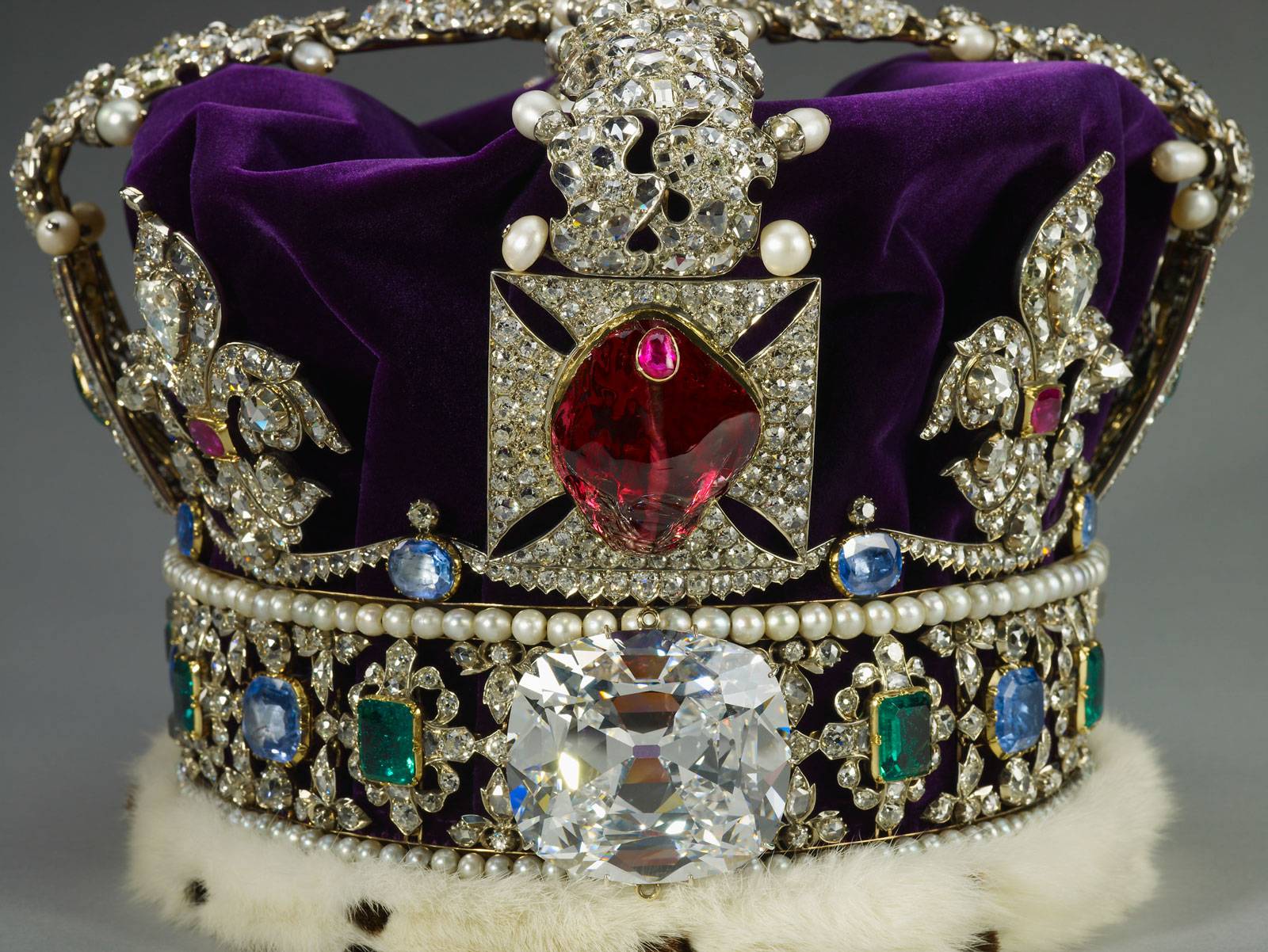 The Black Prince's ruby, a historic red spinel set in the Imperial State Crown and displayed in the Tower of London. A ruby, set in gold, is secured to the top of the spinel. (Photo: S. Greenaway, reproduced with the kind permission of H.M. The Queen. Crown Copyright reserved)