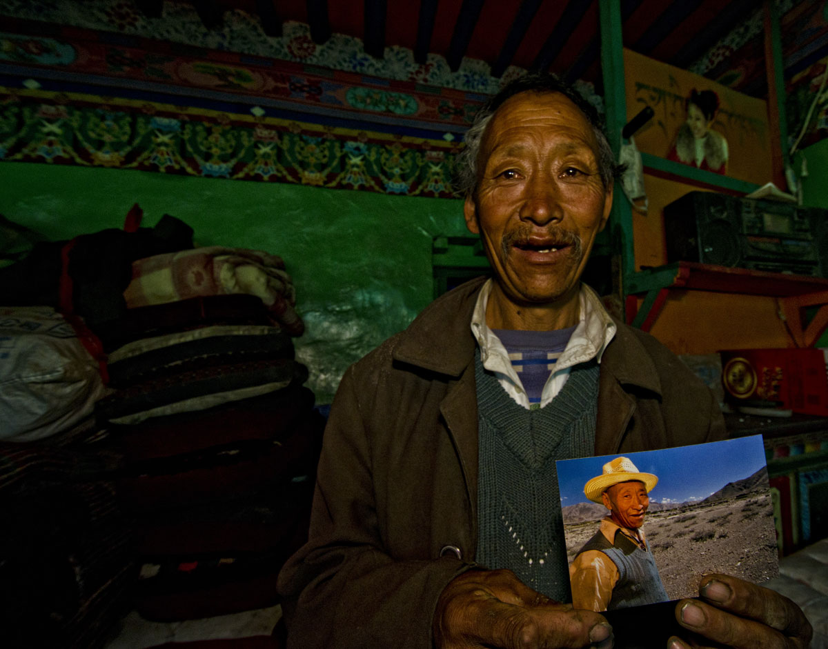 Happiness is… Trilnen Dhongtso of Dhongtso 5 (Zha Lin) village holding a picture of him shot the previous year. He told RWH that many tourists came and took pictures and promised to send them, but RWH was the first who had actually given him a photo. Photo: Richard W. Hughes