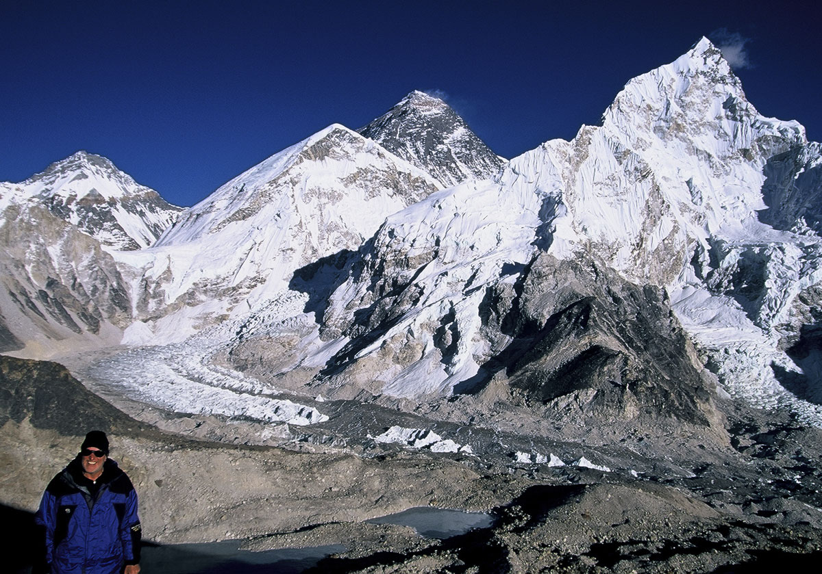 Kala Patar Richard Hughes at Kala Patar above Gorak Shep in Nepal's Khumbu District, with Mt. Everest (center; 8848 m; 29,028 ft) in the background (2003). The author visited Everest from the Nepalese side in 1977 and 2003, but always dreamed of seeing it from the north. The top of Everest (above the yellow band) is actually limestone containing tiny marine fossils. Lhotse (8,414 m; 27,605 ft), fourth highest mountain in the world, dominates the scene to the right of Everest. Photo: Olivier Galibert