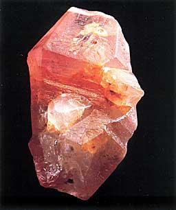 Sri Lankan padparadscha sapphire crystal, 8 by 5 cm; Collection: Paul Ruppenthal; Photo: Studio Hartmann; From Gem & Crystal Treasures by Peter Bancroft