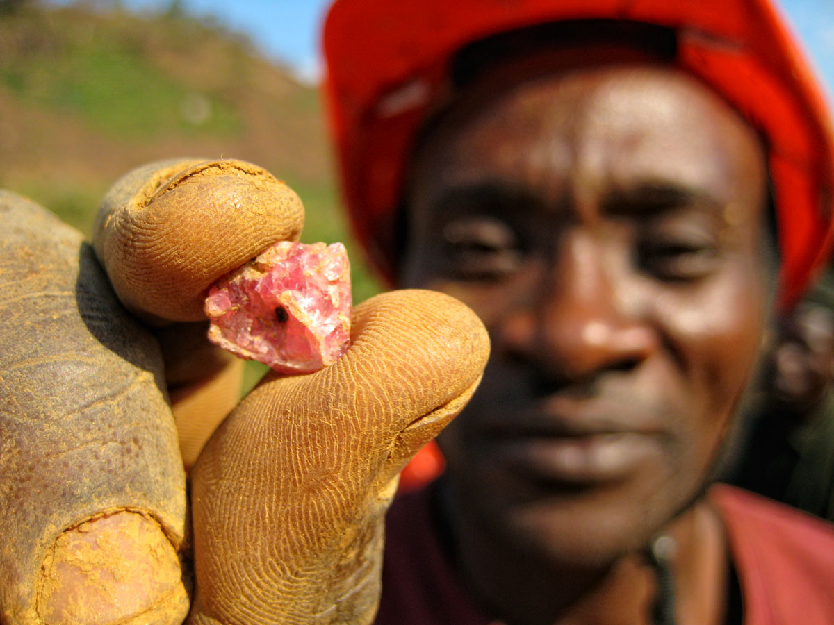 A miner at Ipanko holds a fragment of spinel.