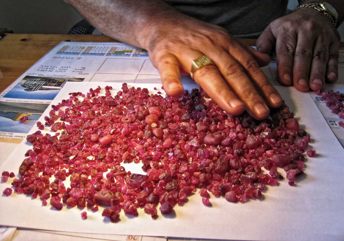 A bit of candy in the office of Spiro, a Morogoro-based Greek dealer. Rough spinel from the Summer 2007 find at Mahenge. Photo © Richard W. Hughes, Lotus Gemology.
