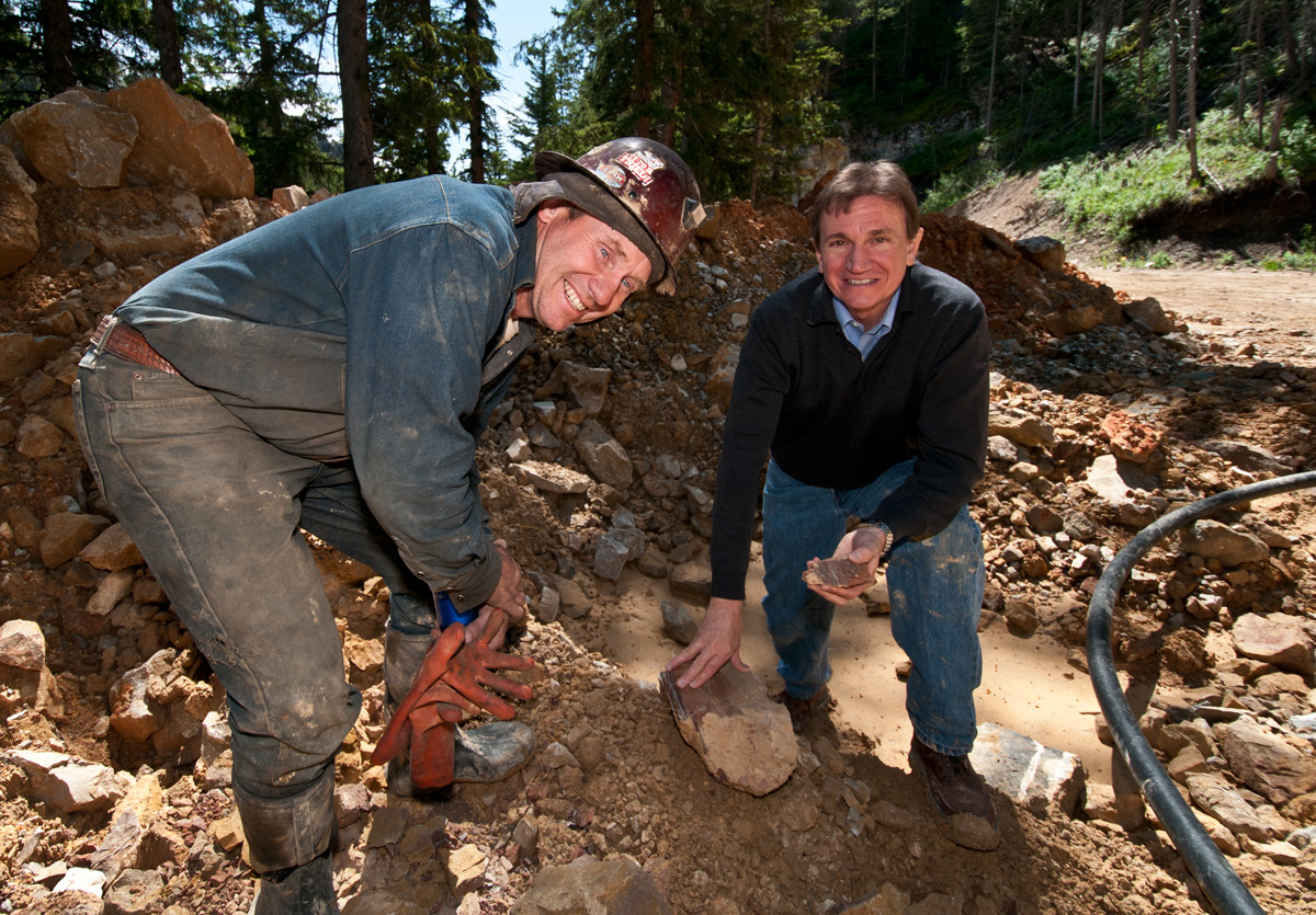 Mike Roberts and Bob Kane examining the tailings outside the Roberts Yogo Sapphire Mine. Click on the photo for a larger image. Photo © Richard W. Hughes