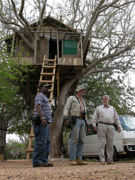 Kennedy Khamwathi, Vincent Pardieu and Campbell Bridges, near Bridges' tree-top house in the Tsavo area.